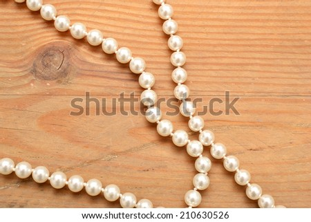 pearl necklace on wood