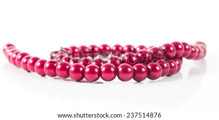 pearl necklace over white surface - stock photo
