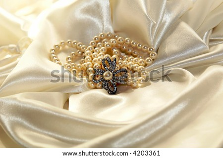Pearls and diamonds on white satin