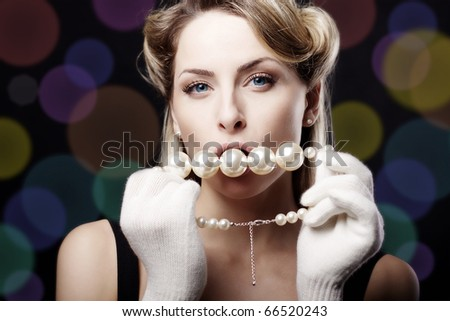 Pearls in his mouth and hand girl - stock photo