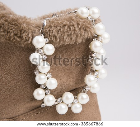 Pearls necklace on white background