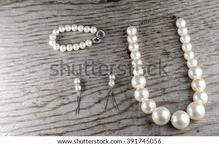 pearls on a wooden table - stock photo