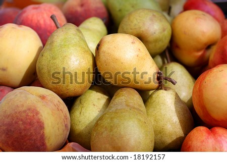 Pears and peaches in the street market