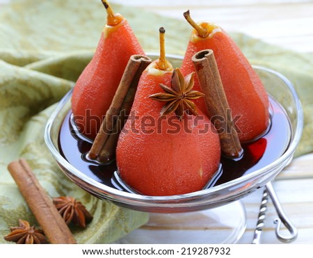pears cooked in wine with spices (cinnamon and anise) - stock photo
