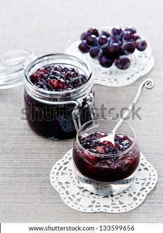 Pears grape jam in glass jar - stock photo