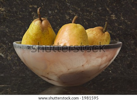 Pears in Alabaster bowl - stock photo