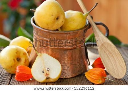 pears in copper jug, autumn still life - stock photo