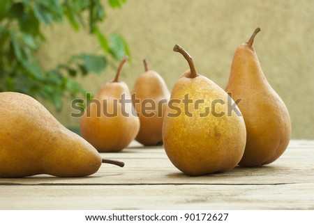 Pears on old wooden table