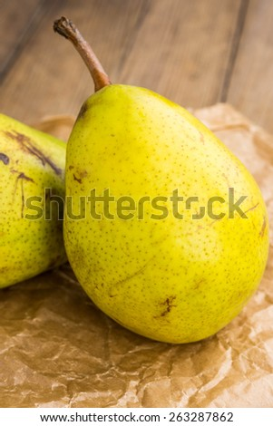 Pears on the wooden table - stock photo