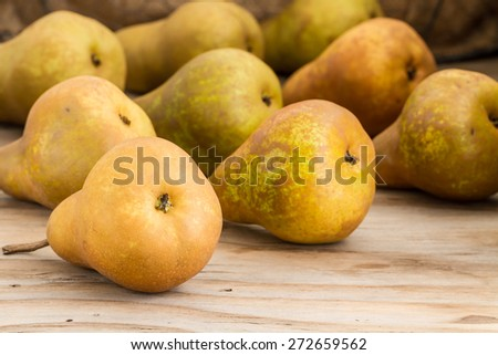 pears on wooden background  - stock photo