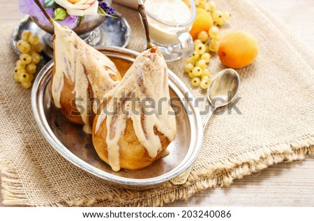 Pears with caramel  - stock photo