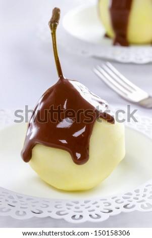 Pears with chocolate sauce - stock photo
