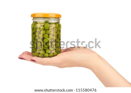 peas in bank on a hand - stock photo
