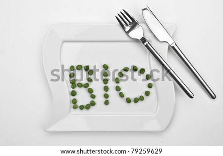 peas on a white plate which are writing bio