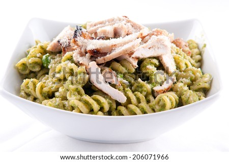 peas pesto with rotini and diced grilled chicken, a delicious healthy meal - stock photo