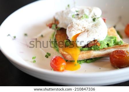 peas poached eggs - stock photo