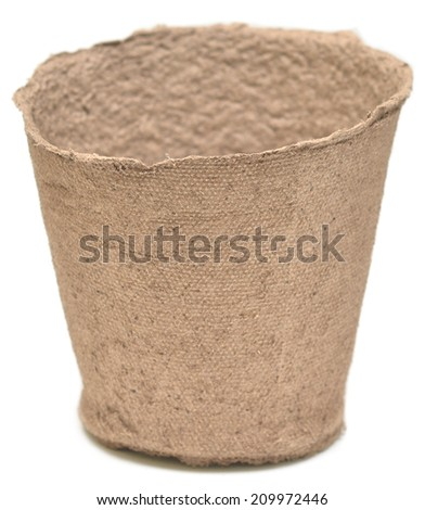 Peat pot for growing seedlings isolated on white background - stock photo