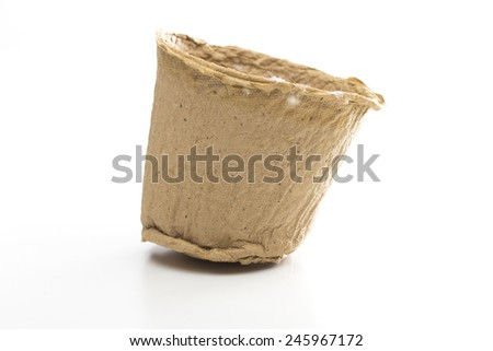 peat pot on the white background - stock photo