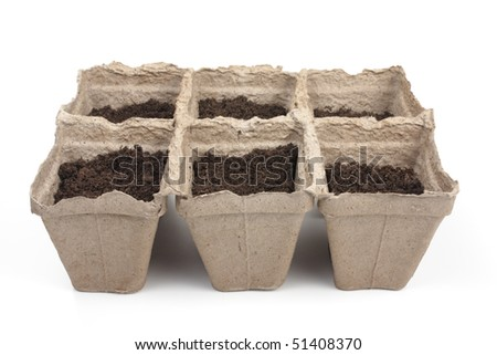 peat pots for seedlings to the ground - stock photo
