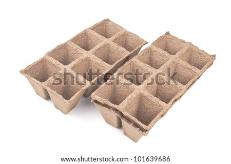peat pots - isolated on white background - stock photo