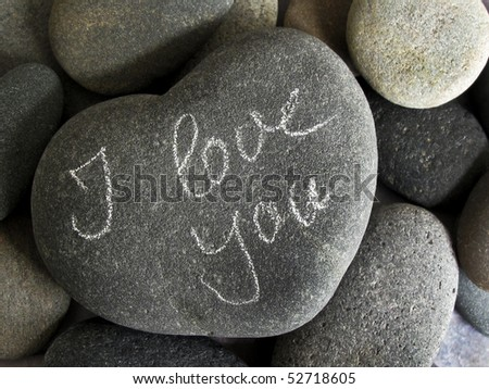 pebble and heart with handwritten text - stock photo