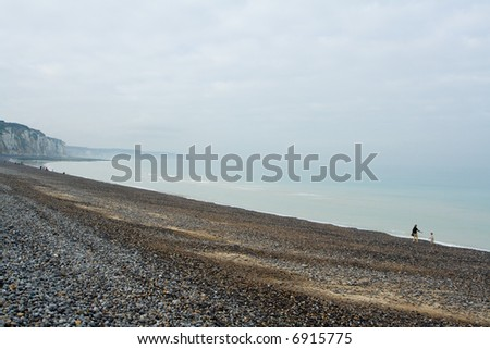 Pebble beach and shoreline at the Alabaster Coast in Dieppe, France. Quiet melancholic day in October. - stock photo