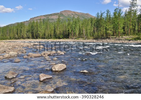 Pebble river Nakta on the Putorana plateau. Water summer landscape of the Siberian mountain rivers. - stock photo