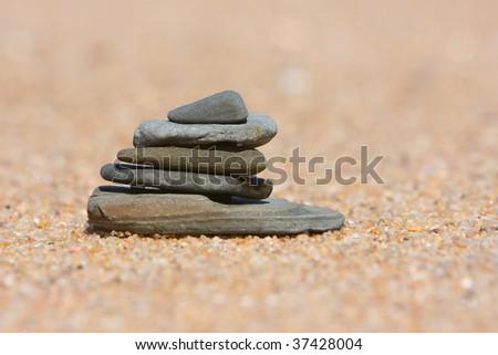 Pebble stack on the beach - stock photo