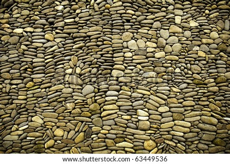 pebble stone wall - stock photo