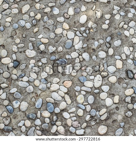 Pebbles and Concrete - Background / Conglomerate of assorted irregular pebbles and concrete - floor or background - stock photo