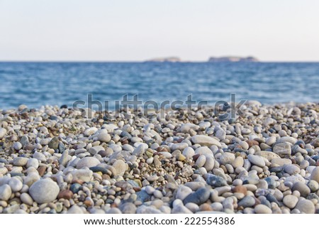 pebbles beach, mediterranean sea, islands - stock photo