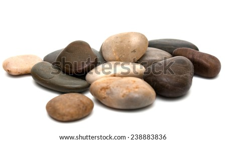 Pebbles heap macro isolated on white - stock photo