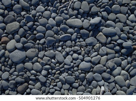 pebbles on a beach background texture wallpaper