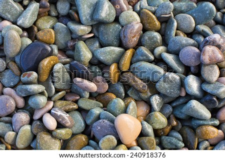 pebbles on the seashore background - stock photo