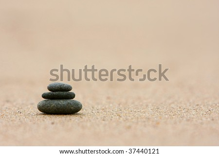 Pebbles stacked on the beach - stock photo