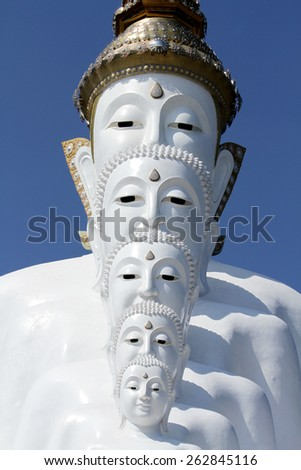 PECHABOON-THAILAND-JANUARY 17 : Close-up row of white Buddha statue on blue sky in the temple, January 17, 2015 Pechaboon Province, Thailand.