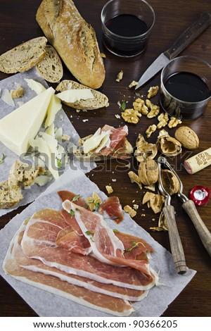 Pecorino Cheese, Parma Ham, Walnuts, Bread and Wine. - stock photo