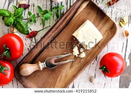 pecorino cheese with tomatoes and spices