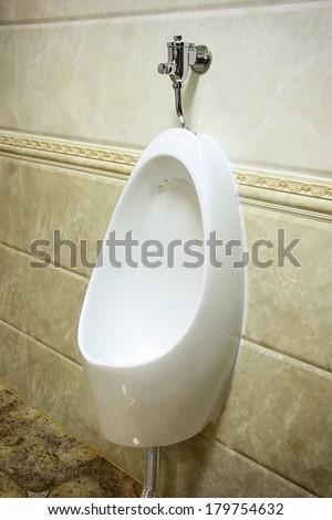 Pedestal urinal in toilet. - stock photo
