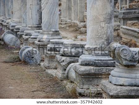 Pedestals of antique Greek marble columns standing in row  Perge ruins, Antalya, Turkey - stock photo
