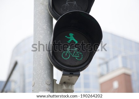 Pedestrian and Bicycle Green Traffic Light in Urban Setting - stock photo