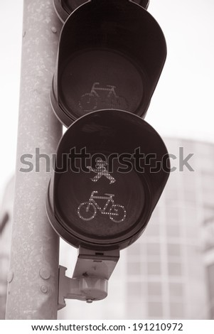Pedestrian and Bicycle Traffic Light in Urban Setting - stock photo