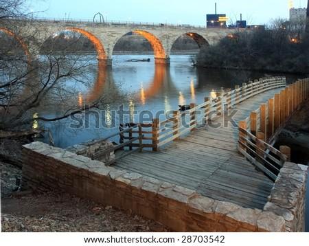 Pedestrian and Stone Arch bridges in Minneapolis - stock photo
