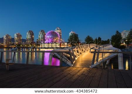Pedestrian Bridge in False Creek, Vancouver Downtown, at Night. - stock photo
