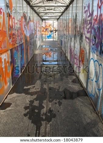 Pedestrian bridge with graffiti - stock photo