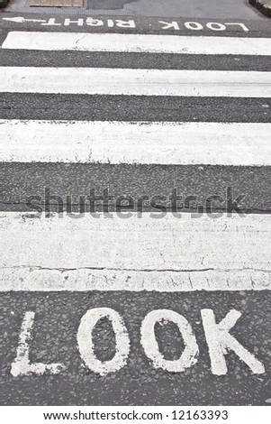 Pedestrian crossing look sign over asphalt - stock photo