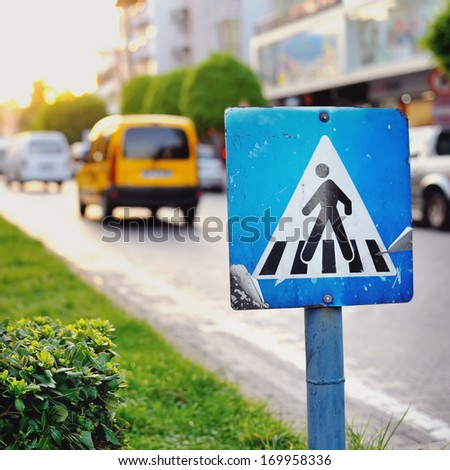 Pedestrian crossing sign close up - stock photo