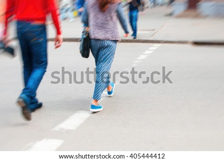 Pedestrian crossing. Urban action lifestyle. Motion blur. Focus only in center. - stock photo