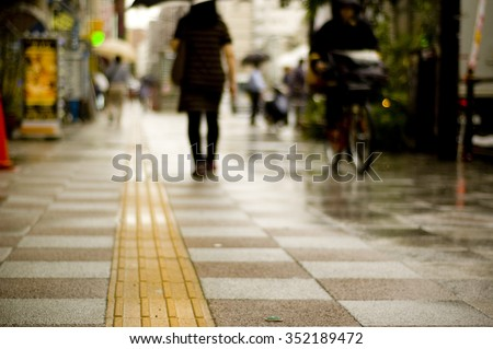 Pedestrian lane for helping blind people in Tokyo, Japan. - stock photo