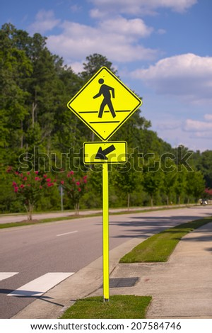 Pedestrian sign in a sunny day at a local road - stock photo